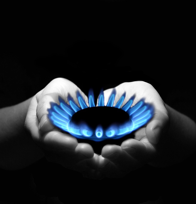 Hands holding a gas flame