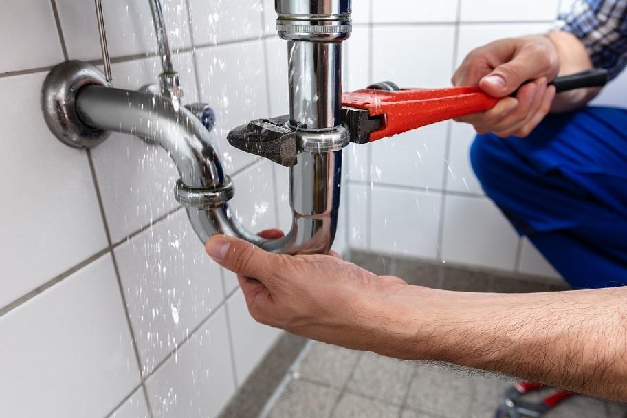 Male Plumber's Hand Repairing Sink Pipe